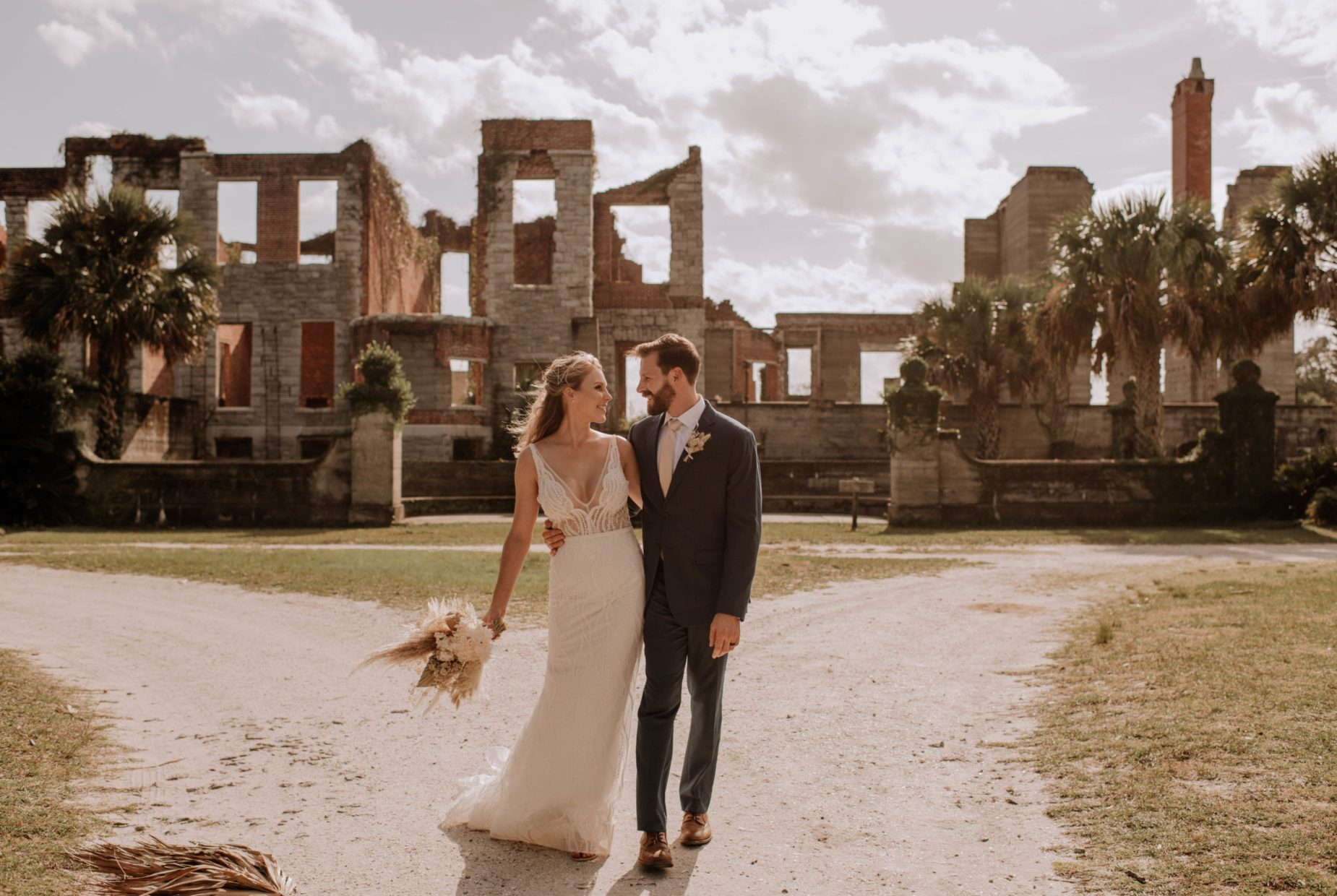 bride and groom walking at Cumberland Island