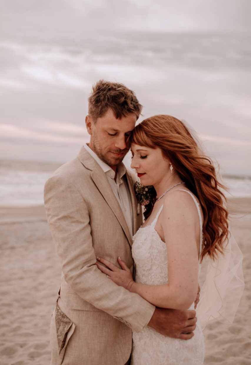 close up of bride and groom on beach