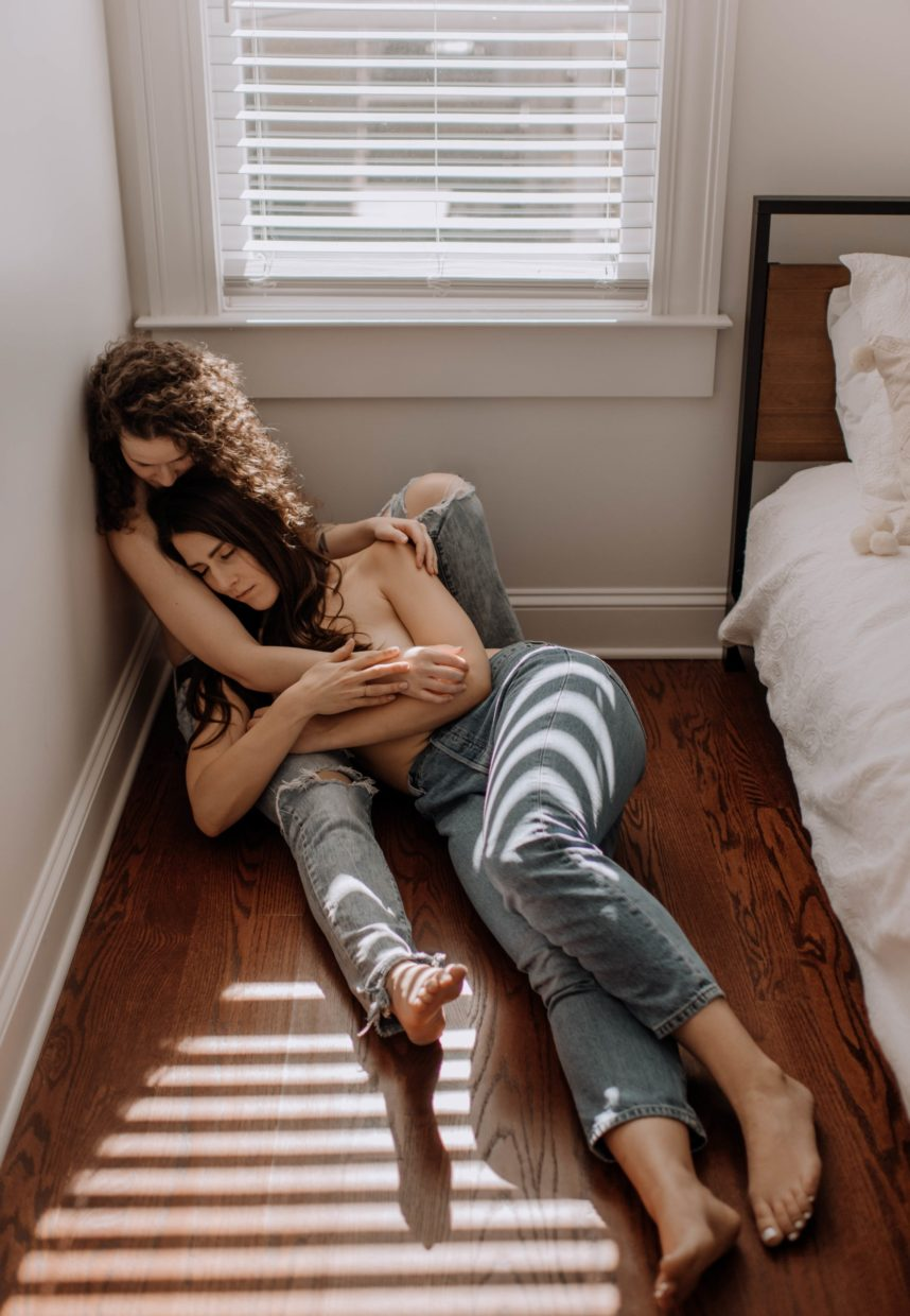 two women in jeans laying together