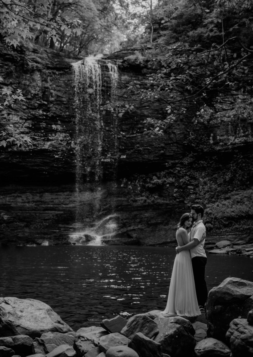 couple hugging at waterfall