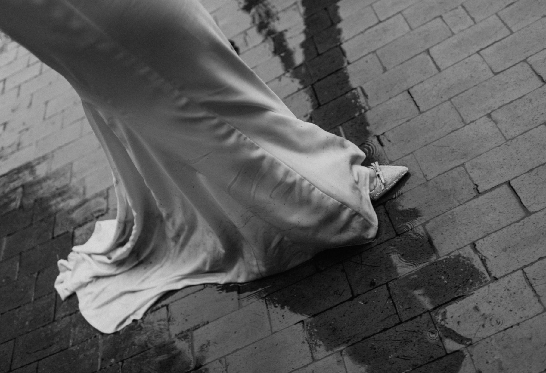bride walking in a puddle