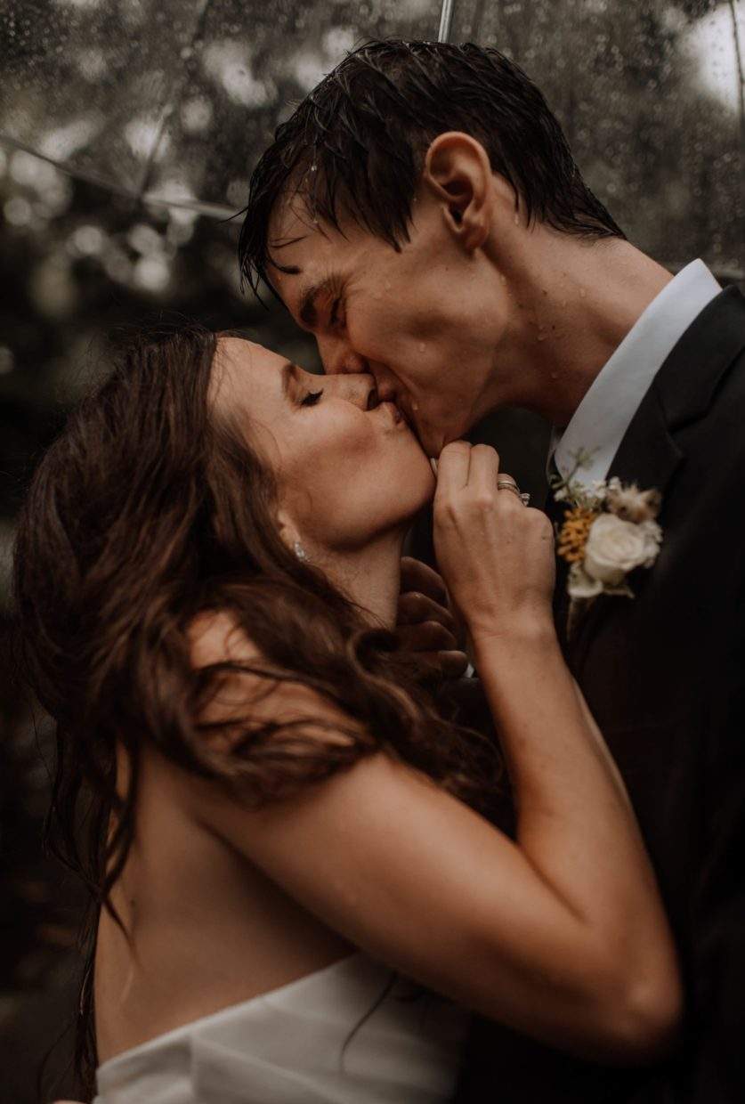 up close bride and groom kissing